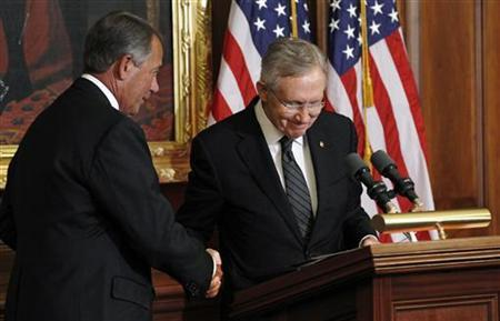 Speaker of the House John Boehner (R-OH, L) shakes hands with Senate Majority Leader Harry Reid during an event awarding the Congressional Gold Medal posthumously to Capitol fresco painter Constantino Brumidi (1805-1880) ''in recognition of his many artistic contributions to the United States Capitol'' in Washington July 11, 2012. REUTERS/Kevin Lamarque