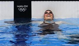 Missy Franklin of the U.S. smiles after winning the women's 100m backstroke final at the London 2012 Olympic Games at the Aquatics Centre July 30, 2012. REUTERS/Jorge Silva