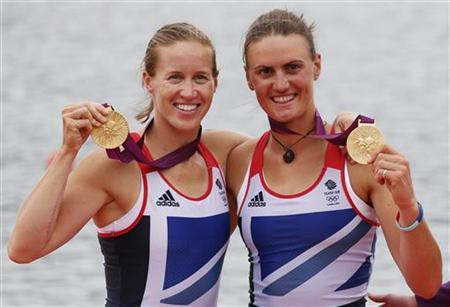 Britain's Helen Glover and Heather Stanning stand with their gold medals after the women's pair Final A at Eton Dorney during the London 2012 Olympic Games August 1, 2012. REUTERS/Jim Young