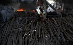 A labourer works inside a steel factory in the eastern Indian city of Siliguri July 16, 2009. REUTERS/Rupak De Chowdhuri