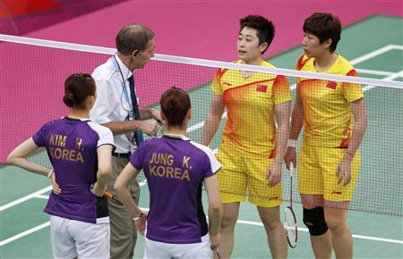 Tournament referee Torsten Berg (2nd L) speaks to players from China and South Korea during their women's doubles group play stage Group A badminton match during the London 2012 Olympic Games at the Wembley Arena July 31, 2012. REUTERS/Bazuki Muhammad