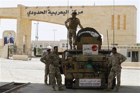 Iraqi Army personnel are deployed at the Rabia border crossing, the main border post between Iraq and Syria, July 23, 2012. REUTERS/Thaier al-Sudani