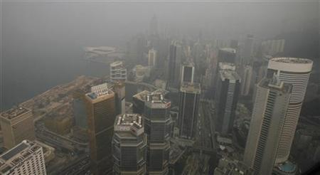 Hotels and commercial buildings at Admiralty and Wanchai districts are seen from the 70th floor of the Bank of China Tower in Hong Kong November 30, 2010. REUTERS/Bobby Yip