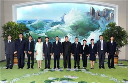 North Korean leader Kim Jong-Un (6th R) poses with Wang Jiarui (6th L), head of the International Liaison Department of China's Communist Party, and other Chinese officials in Pyongyang August 2, 2012 in this picture released by North Korea's official KCNA news agency on August 3, 2012. REUTERS/KCNA