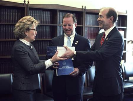 Members of the Republican Budget Committee (L-R) Diane Black of Tennessee, Bill Flores of Texas, and Scott Garrett of New Jersey hold copies of U.S. President Barack Obama's 2012 budget on Capitol Hill in Washington, February 14, 2011. REUTERS/Jason Reed