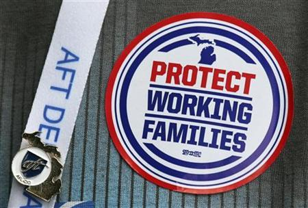 An American Federation of Teachers union member attending the AFT convention in Detroit, Michigan, wears a ''Protect Working Families'' sticker on his shirt to encourage voters to support a November ballot measure that would make collective bargaining a constitutionally protected right in Michigan July 29, 2012. REUTERS/Rebecca Cook