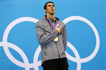 Michael Phelps of the U.S. sings his national anthem with his gold medal on the podium after winning the men's 100m butterfly final during the London 2012 Olympic Games at the Aquatics Centre August 3, 2012. REUTERS/Jorge Silva