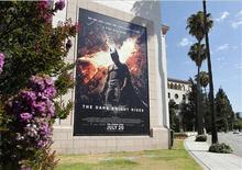 """A poster for the Warner Bros. film """"The Dark Knight Rises"""" is displayed at Warner Bros. studios in Burbank, California, July 20, 2012. REUTERS/Fred Prouser"""
