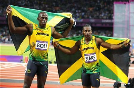 Jamaica's Usain Bolt (L) celebrates winning with countryman Yohan Blake who took second in the men's 100m final during the London 2012 Olympic Games at the Olympic stadium in London August 5, 2012. REUTERS/Brian Snyder