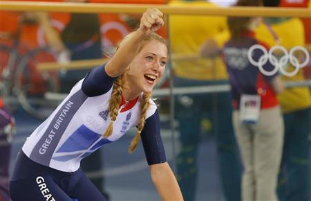 Britain's Laura Trott celebrates after the track cycling women's team pursuit gold finals at the Velodrome during the London 2012 Olympic Games August 4, 2012. Britain set a new world record of 3:14.051. REUTERS/Cathal McNaughton