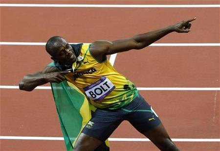 Jamaica's Usain Bolt celebrates after winning the men's 100m final during the London 2012 Olympic Games at the Olympic Stadium August 5, 2012. REUTERS/David Gray