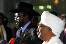 Sudanese President Omar al-Bashir (R) listens as his South Sudanese counterpart Salva Kiir speaks during a joint news conference, before Kiir's departure at Khartoum Airport October 9, 2011. REUTERS/Mohamed Nureldin Abdallah