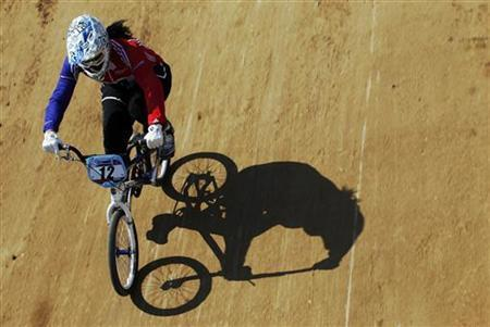 Britain's Shanaze Reade races during a practice session at the UCI BMX Supercross World Cup 2011 series at the VeloPark within the new London 2012 Olympic Park at Stratford in London, August 19, 2011. REUTERS/Luke MacGregor