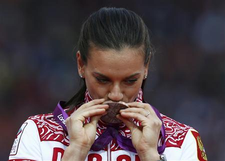 Russia's Yelena Isinbayeva kisses her bronze medal during the women's pole vault victory ceremony at the London 2012 Olympic Games at the Olympic Stadium August 7, 2012. REUTERS/Eddie Keogh
