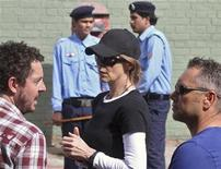 """Oscar-winning director Kathryn Bigelow (C) stands during a shoot at the filming location of the movie """"Zero Dark Thirty"""" in the northern Indian city of Chandigarh March 17, 2012. REUTERS/Ajay Verma"""