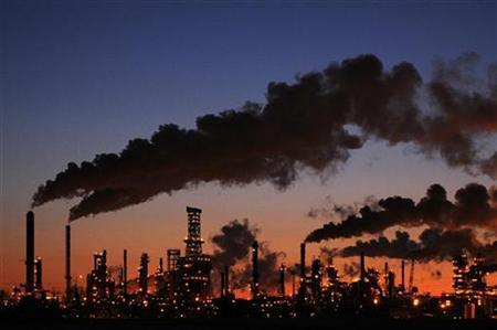 A Refinery and Distribution Centre glows at dusk in Edmonton February 15, 2009. REUTERS/Dan Riedlhuber