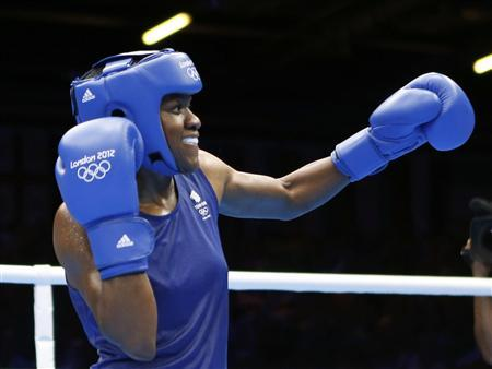 Britain's Nicola Adams celebrates as she fights China's Ren Cancan (not shown) during their Women's Fly (51kg) gold medal boxing match at the London Olympic Games August 9, 2012. REUTERS/Murad Sezer