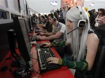 A girl dressed in costume plays a video game at the PAX East gaming conference in Boston, Massachusetts in this April 7, 2012 file photo. REUTERS/Jessica Rinaldi/Files
