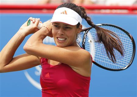 Ana Ivanovic of Serbia hits a return during her match against Roberta Vinci of Italy at the Rogers Cup tennis tournament in Montreal, August 9, 2012. REUTERS/Christinne Muschi