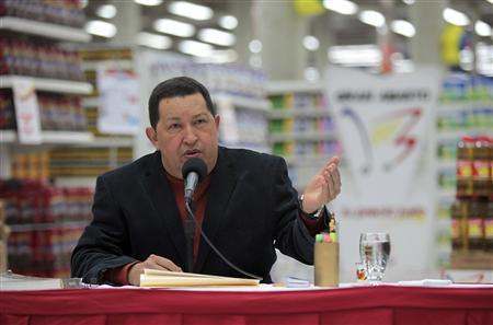 Venezuela's President Hugo Chavez speaks during the opening of a state-run Bicentenario supermarket in Caracas August 8, 2012. REUTERS/Miraflores Palace/Handout