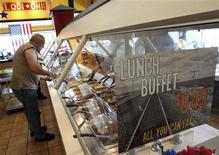 A truck driver selects food from a lunch buffet inside a TA Truck stop in Lodi, Ohio July 9, 2012. REUTERS/Aaron Josefczyk
