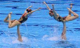 Сборная России по синхронному плаванию на Олимпийских играх в Лондоне, 10 августа 2012 г. Сборная России по синхронному плаванию выиграла награды высшего достоинства Олимпийских игр в Лондоне в командном зачете. REUTERS/Toby Melville