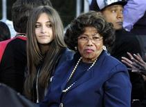 Michael Jackson's daughter Paris (L) and mother Kathleen attend a ceremony where the singer is immortalized by placing hand and foot imprints in cement in the courtyard of Hollywood's Grauman's Chinese Theatre in Los Angeles on January 26, 2012. REUTERS/Phil McCarten