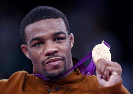 Jordan Ernest Burroughs of U.S. poses with his gold medal at the podium of the Men's 74Kg Freestyle wrestling at the ExCel venue during the London 2012 Olympic Games August 10, 2012. REUTERS/Grigory Dukor
