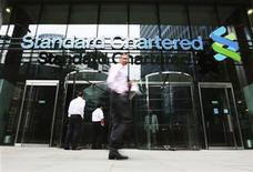 An exterior view of the Standard Chartered headquarters is seen in London August 7, 2012. REUTERS/Olivia Harris