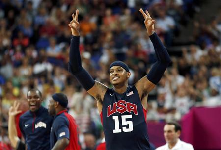 Carmelo Anthony of the U.S. celebrates after a made three-point basket against Argentina during their men's basketball semifinal match at the North Greenwich Arena during the London 2012 Olympic Games August 10, 2012. REUTERS/Mike Segar