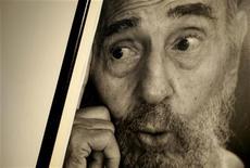 A photograph of former Cuban President Fidel Castro taken by Castro's son Alex Castro, is seen during an exhibition in Havana July 10, 2012. REUTERS/Enrique de la Osa