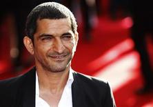 """Actor Amr Waked arrives for the European premiere of """"Salmon Fishing in the Yemen"""" at the Odeon Kensington in London April 10, 2012. REUTERS/Luke MacGregor"""