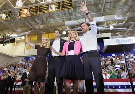 U.S. Republican presidential candidate Mitt Romney (R) and his wife Ann (2nd R) wave to supporters together with his running mate U.S. Congressman Paul Ryan (R-WI) (2nd L) and Ryan's wife Janna during a campaign event in Ashland, Virginia August 11, 2012 file photo. REUTERS/Shannon Stapleton/Files