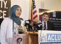 Former Disney employee Imane Boudlal (L) speaks as American Civil Liberties Union (ACLU) Chief Council Mark Rosenbaum looks on at a news conference announcing a federal lawsuit against Disney alleging discrimination and harassment because of her religious beliefs at ACLU headquarters in Los Angeles, California August 13, 2012. Boudlal, a 28-year-old Muslim, worked as a hostess at the Storytellers Cafe, a restaurant inside Disney's Grand California Hotel & Spa at Disneyland in Anaheim, California, according to a complaint filed in federal court. REUTERS/Jason Redmond