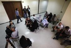 People wait for their cases to be heard at Rusafa criminal court in Baghdad August 14, 2012. REUTERS/Mohammed Ameen