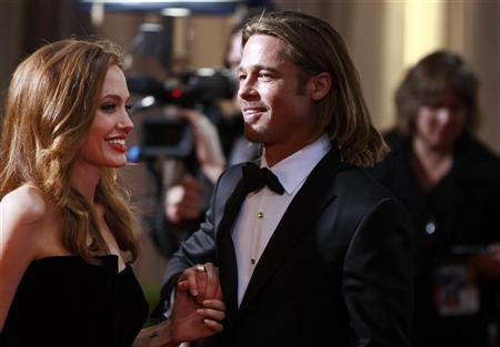 Actress and presenter Angelina Jolie and her partner actor Brad Pitt arrive at the 84th Academy Awards in Hollywood, California, February 26, 2012. REUTERS/Lucas Jackson