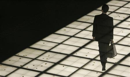 A businessman walks on an illuminated walkway in Tokyo November 13, 2008. REUTERS/Yuriko Nakao