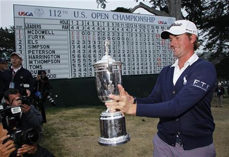 Webb Simpson poses with the U.S. Open Championship Trophy following 2012 U.S. Open golf tournament on the Lake Course at the Olympic Club in San Francisco, California June 17, 2012. REUTERS/Danny Moloshok