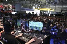 Members of team Team SoloMid (TSM) from the United States are shown competing during the 2011 League of Legends competition of the Intel Extreme Masters Gamescom in Cologne, Germany in this publicity photo released to Reuters on August 17, 2012. REUTERS/Gamescon/Handout