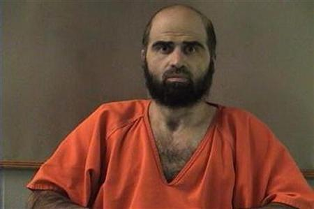 Nidal Hasan, charged with killing 13 people and wounding 31 in a November 2009 shooting spree at Fort Hood, Texas, is pictured in an undated Bell County Sheriff's Office photograph. A military judge ruled Friday not to delay Hasan's August 20 trial, and also banned Hasan from court until he shaves his beard. REUTERS/Bell County Sheriff's Office/Handout.