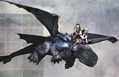 """Actors Riley Miner and Gemma Nguyen are shown on the back of the character Toothless from the stage production of Dreamworks """"How to Train Your Dragon Live Spectacular"""" in this publicity photo released to Reuters on August 16, 2012. REUTERS/Todd Kaplan/Handout"""