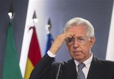 Italy's Prime Minister Mario Monti gestures during a news conference at the Moncloa Palace in Madrid August 2, 2012. REUTERS/Juan Medina
