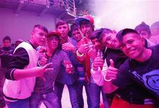 Fans of reggaeton music, known as 'Reggaetoneros' pose for a picture during a party at a dance club in Ecatepec, on the outskirts of Mexico City August 17, 2012. Reggaeton, a Caribbean fusion of hip hop with Latin timbres, is wildly popular across Latin America but is raising eyebrows in Mexico City. Fans of the sexually-explicit music have become Mexico's persona non grata of the moment, blamed for a string of offenses ranging from theft to drug dealing. Picture taken August 17, 2012. To go with story MEXICO-REGGAETONEROS/ REUTERS/Bernardo Montoya