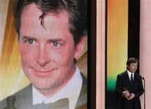 U.S. actor Michael J. Fox holds his international lifetime achievement award during the 46th 'Goldene Kamera' (Golden Camera) awards ceremony at the Ullstein Auditorium in Berlin, February 5, 2011. REUTERS/Tobias Schwarz