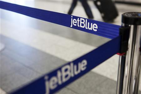 A JetBlue Airways logo is seen at the check-in counter at LaGuardia Airport in New York April 5, 2012. REUTERS/Lucas Jackson