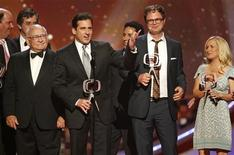 """Presenter Ed Asner (L) looks on as the ensemble cast of the TV series """"The Office"""" (2nd L-R) Steve Carrell, Oscar Nunez, Rainn Wilson and Angela Kinsey accept the Future Classic award at the taping of the 6th annual TV Land Awards in Santa Monica June 8, 2008. REUTERS/Fred Prouser"""