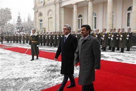 Armenian President Serzh Sargsyan (C) walks with Iran's President Mahmoud Ahmadinejad (R) during an official welcoming ceremony in Yerevan December 23, 2011. REUTERS/Tigran Mehrabyan/PanARMENIAN Photo/Handout