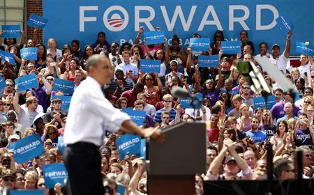 Supporters cheer as U.S. President Barack Obama speaks during a campaign event at Capital University in Columbus, Ohio August 21, 2012. REUTERS/Kevin Lamarque