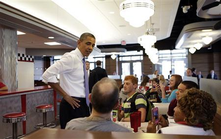 U.S. President Barack Obama visits Sloopy's diner inside the student union at the Ohio State University in Columbus, Ohio August 21, 2012. REUTERS/Kevin Lamarque