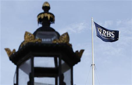 A flag flies over the former headquarters and registered office of the Royal Bank of Scotland (RBS) in Edinburgh, Scotland March 29, 2012. REUTERS-David Moir